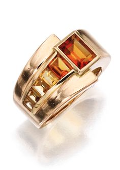 *GOLD AND CITRINE RING, RENÉ BOIVIN The polished gold band set with a graduated row of six citrines, gross weight approximately 4 dwts, size 4¾; circa 1940