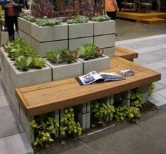 Cinder Block Garden Wall... with seating. This would be great with any plants. However, I am considering this for my strawberries!