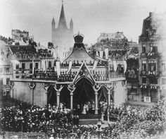 10-15-1880-This rededication of the Cologne Cathedral, whose final stage of building had begun decades earlier under Prussian King Friedrich Wilhelm IV, was attended by Kaiser Wilhelm I and his wife, Kaiserin Augusta, both of whom can be seen at the center of this contemporary photograph. Considerable planning and effort must have gone into the construction of the visitors' gallery. Multi-tiered seating was even provided for those dignitaries willing to perch on rooftops.