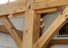 "Red oak hardwood spline with a 2"" reveal and shaped corners. Wise Owl Joinery Co., Handcrafted timber structures"