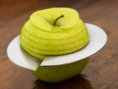 Effortless and elegant. Slices the  perfect spiral form around the  apple's core.