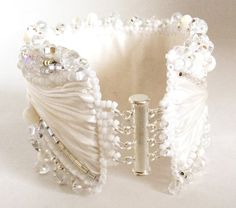 Swarovski Crystal Beaded Shibori Ribbon Cuff by ReneGibson on Etsy for the clip idea Ribbon Jewelry, Lace Jewelry, Fabric Jewelry, Bridal Jewelry, Diy Jewelry, Jewelery, Handmade Jewelry, Jewelry Design, Jewelry Making