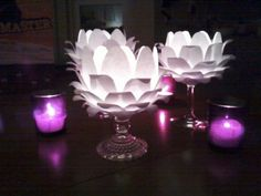 diy glowing flower centerpieces.....made with paper, wineglasses and tealights.