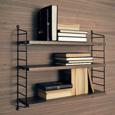 String Pocket Shelf.  Black steel frame with wood shelves.   Made to go with an Eames Lounge Chair!
