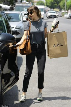 3e5b0dc8d7a048 Dakota Johnson dons casual style as she goes bra free for a shopping trip  in Los