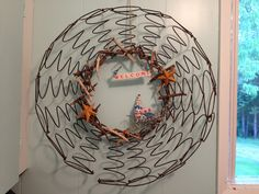 Wreath made from old bed springs, twigs, & a little birdy.