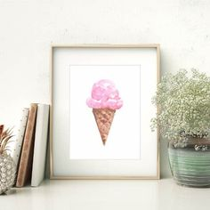 Channel those warm summer days with this hand painted watercolor ice cream print. It features a beautiful pink strawberry ice cream cone - a great addition to any kitchen or home decor!