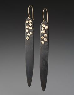 "Peg Fetter - Earrings in steel and 14k yellow gold. 3"" in length. gilders paste and copper basic bead. Cut my own tiny stuff from what?"