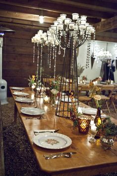 The wooden bare table and place settings- not centre pieces