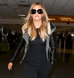 The curvy reality TV star showed off her stunning new hair color as she emerged from LAX on Sunday, March 1, following a night away for Ryan Seacrest's 40th birthday party — and she looked amazing!