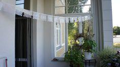 Wimpelkette von der anderen Seite ! Der Balkon ist hübsch gemacht !