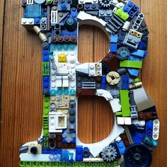 Wooden letter with Lego bits