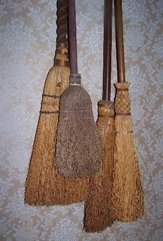 Sheepscot River Primitives - the old brooms make a nice wall display hanging from shaker pegs.