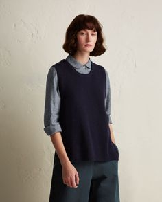 Fisherman rib vest in a lightweight, soft and springy wool/cotton. Double rib trim at neck. Tapered, split hem dropped lower at the back. Fashioning at neckline, arm holes and split hem.