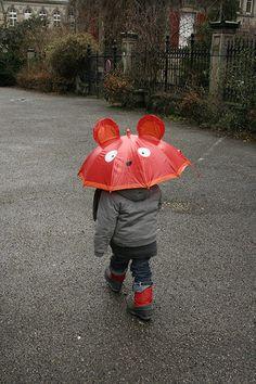 Red umbrella by sushimiam, via Flickr.com