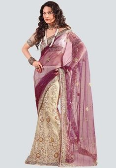 Embellished saree for women from Ashika. Made of net, the saree measures 6.30m, including the blouse piece. Sparkle in your ethnic wear by sporting this sizzling net saree from the covetable collection of Ashika. Featuring dazzling embellishment in an exquisite design, this sheer saree will lend you a feminine and sexy look.
