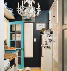 bright blue door, black walls make a cute little accent!