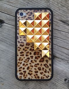 Leopard print and gold studs in a pyramid formation, hand-crafted onto a durable, matte black iPhone 4/4s rubber bumper. This design will be available for the iPhone 5 case.