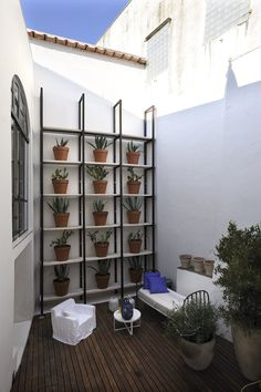 shelf of pots for small outdoor space