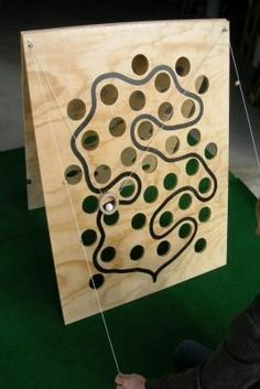 DIY simple wooden game [no instructions in link though]. Don't forget to put knots in the strings so the playing piece rests on the bottom start & finish spot Wooden Projects, Projects For Kids, Diy For Kids, Wood Crafts, Diy Projects, Backyard Games, Outdoor Games, Woodworking Toys, Woodworking Projects