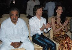 British rock star #MickJagger, centre, applauds as he watches a performance with girlfriend L'Wren Scott and Maharajah of Jodhpur Gaj Singh II during the Rajasthan International Folk Festival (RIFF) in Jodhpur. (AP Photo)   Visit : www.newindianexpress.com