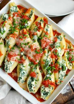 Stuffed Shells are a comforting, filling meal that makes the perfect meal for a large group. Large pasta shells are stuffed with a lemony-chive cheese mixture and topped with tomato sauce. They are baked to perfection and will warm you right up! Budget Freezer Meals, Frugal Meals, Easy Meals, Big Meals, Pasta Recipes, Dinner Recipes, Cooking Recipes, Dinner Ideas, Budget Recipes