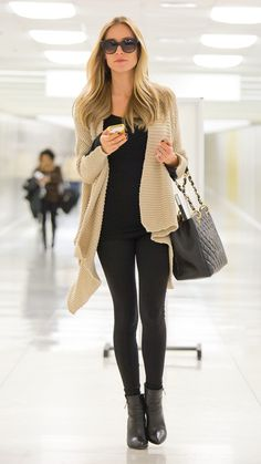 Kristin Cavallari arrives at LAX in all black and a long camel cardigan. via @stylelist