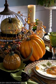 beautiful tablescape... I found the small pumpkin dish at St. Vincent de Paul last week, 4 of them in fact, for $2.99.