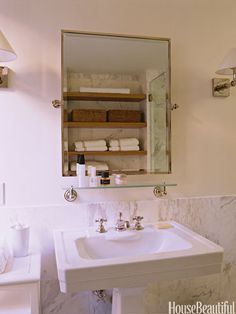 City Bathroom In the master bath of Ina Garten's New York apartment, Calacatta marble sets off the Exeter pedestal sink and the mirror, both by Waterworks.