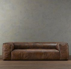 Restoration Hardware, need I say more?  This sofa is so simple, yet I don't think I have ever seen anything like it.  I really like it.: