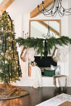 Get in the holiday spirit by decorating your home with artificial pine, mistletoe, holly, christmas garlands and pine wreaths. Keep holidays simple with Afloral. Bohemian Christmas, Classy Christmas, Minimal Christmas, Christmas Greenery, Christmas Fireplace, Farmhouse Christmas Decor, Green Christmas, Christmas Home, Christmas Ideas