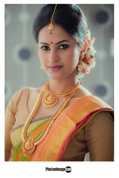 South Indian bride. Temple jewelry. Jhumkis.Yellow silk kanchipuram sari with contrast gold blouse.Braid with fresh flowers. Tamil bride. Telugu bride. Kannada bride. Hindu bride. Malayalee bride.Kerala bride.South Indian wedding.