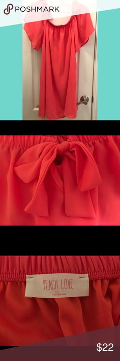 "*NWOT* Cute off the shoulder coral dress 🎀 *NWOT* *""Just like honey"" off the shoulder coral dress with cute bow details* *purchased from The Red Dress Boutique* Peach Love California Dresses Strapless"