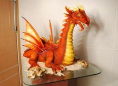 Orange sculpted dragon cake
