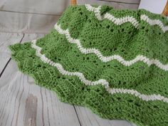 Green and ivory crochet baby blanket. This is a very special handmade crochet baby blanket.  This baby afghan will make a wonderful baby shower gift.  This is a chevron type pattern but with more of a ripple effect.  This blanket would make a lovely addition to your baby nursery decor. Perfect also, for travel, strollers, prams, cribs, tummy time and photo props.
