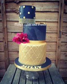 Offset tiered black and gold cake