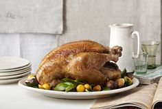 The centerpiece of your holiday meal, the turkey is one dish you want to get just right—and with this foolproof recipe, you can roast a beautiful, succulent turkey every time. Quick tip: For a fresh garnish that won't wilt, choose stiff, glossy leaves. Here, bay and citrus leaves pair with figs and kumquats.