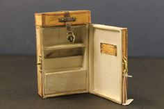 This smaller miniature steamer trunk has all the organization of the larger trunks, and additional storage under the top of the trunk.
