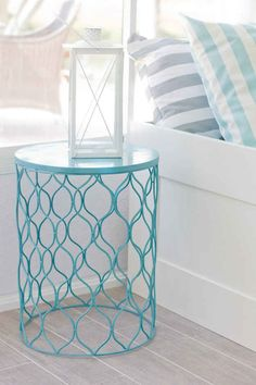 Even easier: Find, flip, and paint a wire trashcan for a stylish side table.