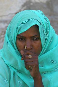 Eritrean woman, aqua blue, pensive, by Eric Lafforgue