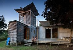Love the lightweight low-tech feel.  Fun with water catchment tower too!    Herbst Architects