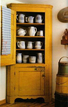 Corner cupboard in mustard color...