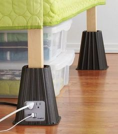 Bed Risers with USB Power Strip. Available at Bed, Bath, and Beyond. A seriously good idea for dorm rooms as it seems something always needs to be charged! Diy Para A Casa, Dorm Hacks, Bed Risers, Dorm Room Organization, Organizing, Clothing Organization, Organization Ideas, Dorm Life, Dorm Ideas