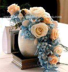 Peach and blue centerpiece but another flower and color to go with the blue!