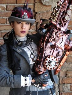 Steampunk U.S. Marshal - woman with big steampunk gun  - For costume tutorials, clothing guide, fashion inspiration photo gallery, calendar of Steampunk events, & more, visit SteampunkFashionGuide.com