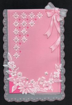Bows and flowers done with pink card stock, outlined in pink ink and pearls added as an embellishment.