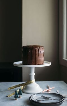 Vegan Chocolate Peppermint Cake | This chocolate peppermint cake is covered in a dairy free chocolate ganache and is perfect for the holidays! | thealmondeater.com