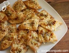 galletitas saladas exprés de queso Para 16 unidades 3 unidades = 1 propoint 4 obleas pequeñas para empanadillas (4pp) 20 gr queso emmental rallado (2pp) orégano seco pimentón picante