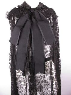 Victorian 1880s Bustle Chantilly Lace Cape Coat. Chantilly lace with silk bow accents and beaded yoke. Detail