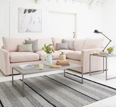 Loaf's pale pastel pink Pavilion even-sided corner sofa bed with concrete…